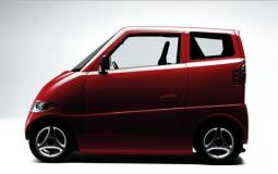 Beautiful dark red small car with two doors.JPG