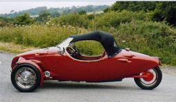 Convertable red small sport cars with three wheels.JPG