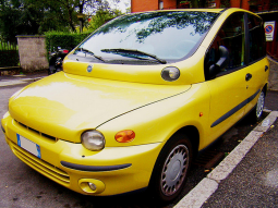 Bright yellow Fiat car photos.PNG