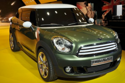 Green mini cooper with white top.PNG