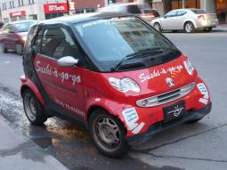 picture of red Smart car on the street.jpg