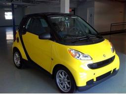 bright yellow Smart car images.jpg