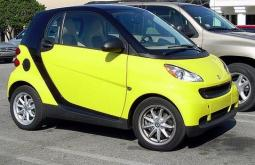 very bright yellow Smart car on the road.jpg