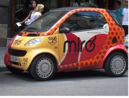 orange and yellow Smart Car pictures.jpg