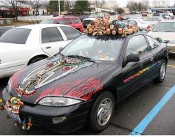 funky picture of car with great collection items.jpg