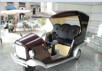 Image of a funky three wheeled car with a classic style.jpg