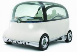 picture of a funky car_ a white Honda PUYO model.jpg