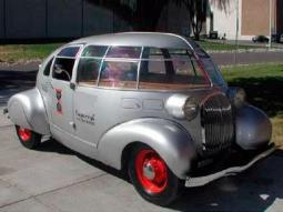 very funky car in silver and red.jpg