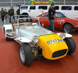 classic short funky car in silver and  yellow.jpg