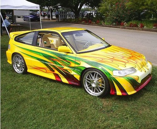 yellow custom car with other colorful paint lines.jpg