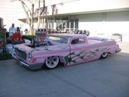 Cool custom car in light pink and green lines.jpg