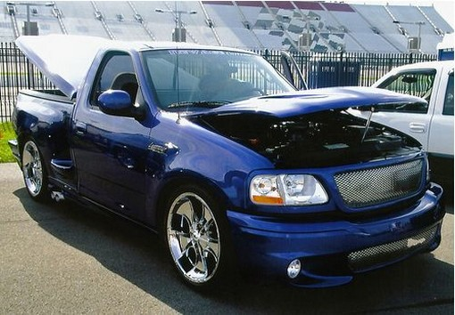 dark blue Ford Lighting at Nashville Super Speedway car show photo.jpg