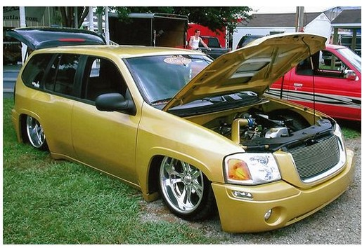 GMC Envoy car in dark gold color.jpg