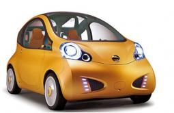 picture of electric city car circa 2015 in yellow with two doors.JPG