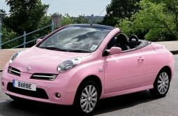 Very cute light pink convertable Nissan car with two cars picture.JPG