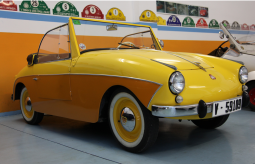 Bright yellow 1959 PTV 250 Convertible_very cool and funky car image.PNG