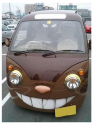 Classic van painted with evil smile face.PNG