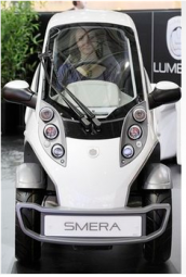 Manufacturer Lumeneo shows the just 86 centimeter wide electric car Smera at the Geneva Motor Show in Geneva, Switzerland.PNG