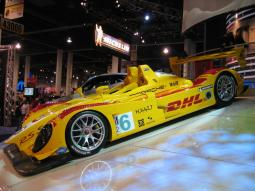 LeMans Porsche DHL Race Car in bright yellow.jpg