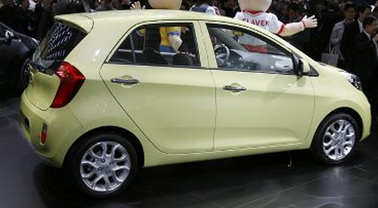 2012 Kia Picanto car in creamy yellow.PNG