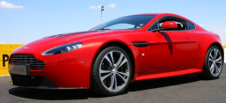 2011 Aston Martin V12 Vantage cars in bright red.PNG
